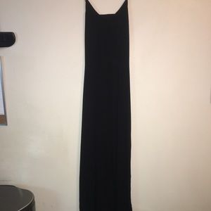 Express black maxi with cut out in back .
